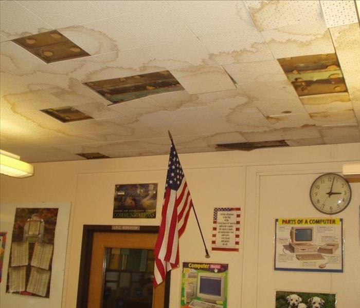 school classroom with water damaged ceiling