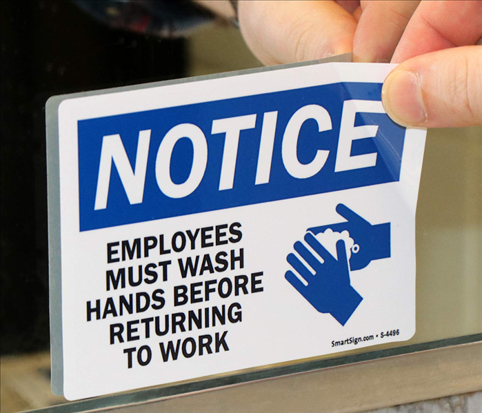 removing sticker that reads emplyees must wash hands before returning to work